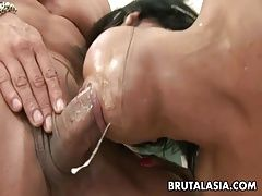 Asian bitch shares two rock hard...