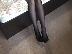 Stepsister in pantyhose. Footjob