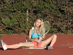 Blonde Teen Playing Tennis And...