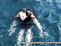 Three girls swimming nude in the...
