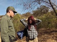 Red head blows outdoors