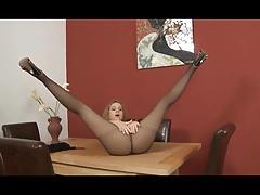 Girl teases in black pantyhose